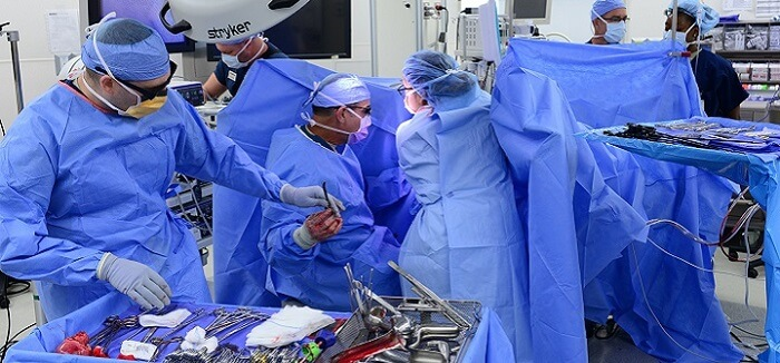 several surgeons and medical staff